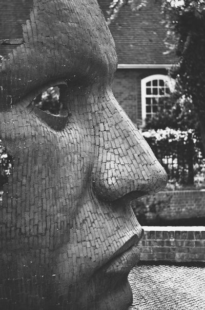 Mask, Marlowe Theatre Art And Craft Statue Sculpture No People Close-up Day Outdoors Architecture Building Exterior Blackandwhite The Street Photographer - 2017 EyeEm Awards Sculptures Face EyeEm Best Shots VSCO