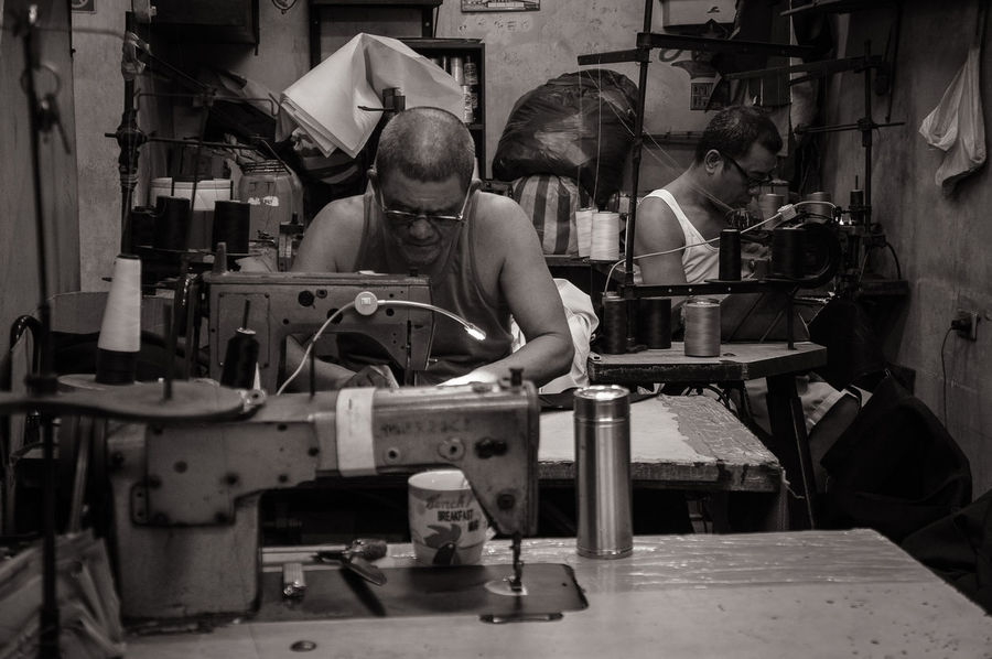 Tailors busy sewing dresses in a shop in Quiapo district in Manila. Dress Shop Everyday Scene Industry Portrait Sew Sewing Machine Tailored To You Working Hands Workshop