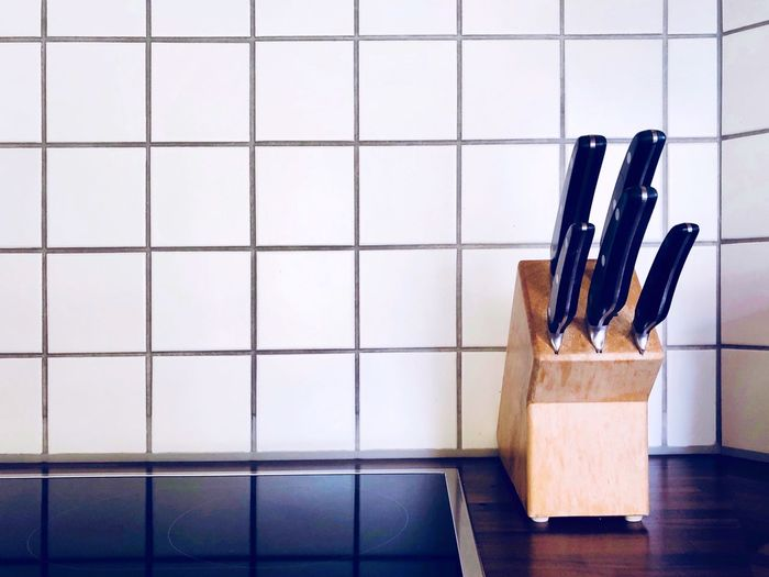 Knives on counter in kitchen
