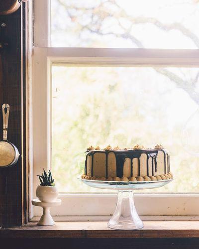 Chocolate peanut butter cake Desserts Homemade Celebration Birthday Cake Cake Window Indoors  Day Window Sill No People Home Interior Sunlight Close-up