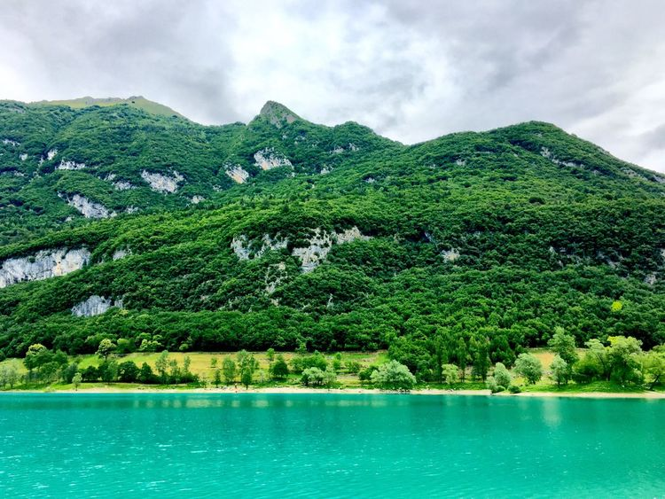 Mountains Beautiful View Green Forest Green Trees Grey Clouds Blue Water Azure Water EyeEmNewHere Green Mountains Tenno Lake Pierie Trees Clouds Blue Nature Outdoors Water The Traveler - 2018 EyeEm Awards The Great Outdoors - 2018 EyeEm Awards