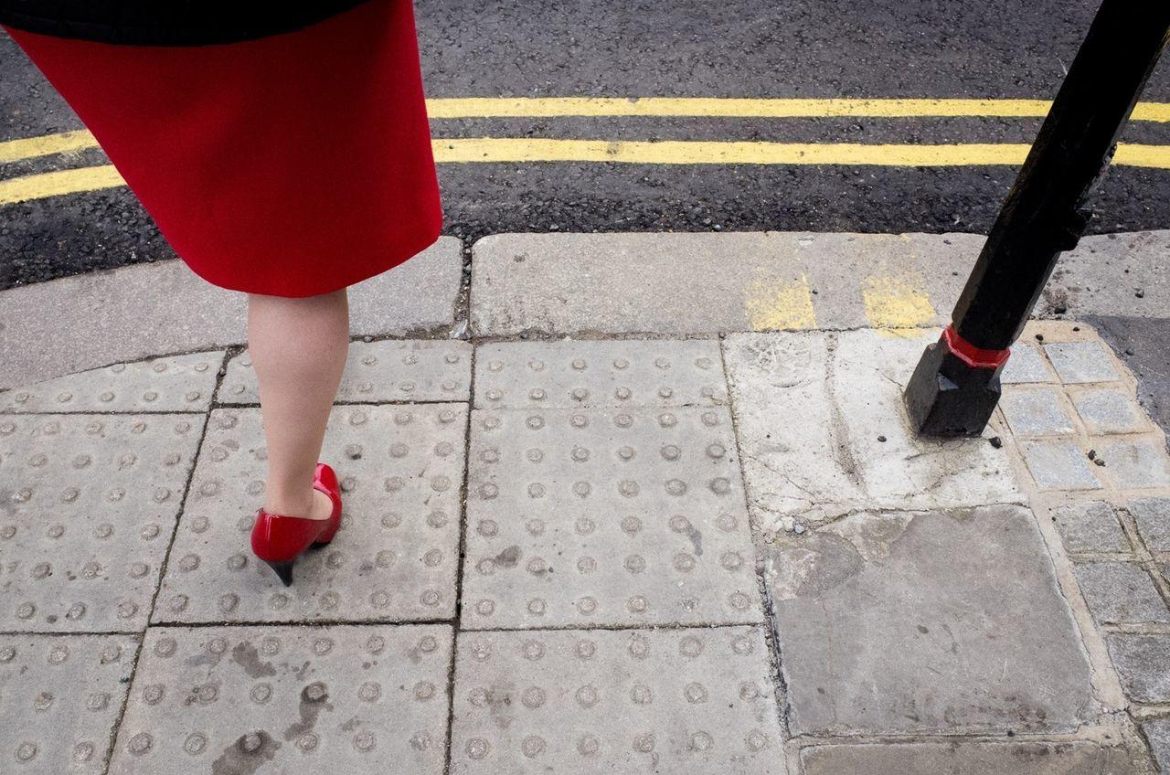 Woman on pavement