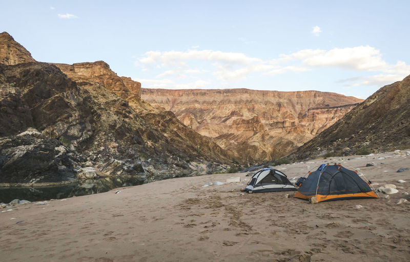Campsite on sand banks next to a river in a rugged canyon Adventure Beauty In Nature Camping Exploration Explore Hike Hiker Hiking Leisure Activity Mountain Mountain Range Nature Nature No People Outdoor Outdoor Photography Outdoors Rugged Sand Scenics Summer Tent Travel Wild Wilderness