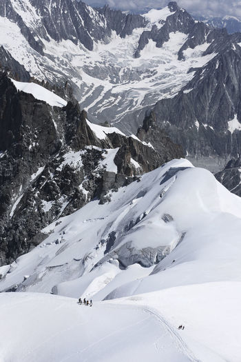Views from LA'Aiguille Du Midi in Chamonix, France. In the image climbers ascending Mont Blanc with an official altitude of 4810.06 meters. It is the highest point in the European Union