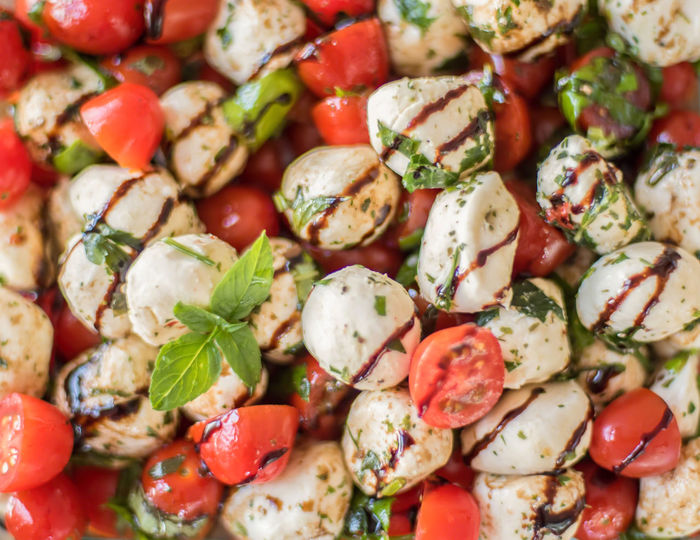 Basil Freshness Healthy Eating; Homemade Salad Backgrounds Balsamic Basalmic Capri Close-up Colorful Drizzled Food Food And Drink Freshness Full Frame Healthy Eating Indoors  Leaf No People Recipe Sprig Tomato Vegetable