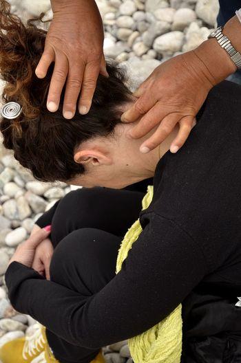 Cropped hand massaging woman neck