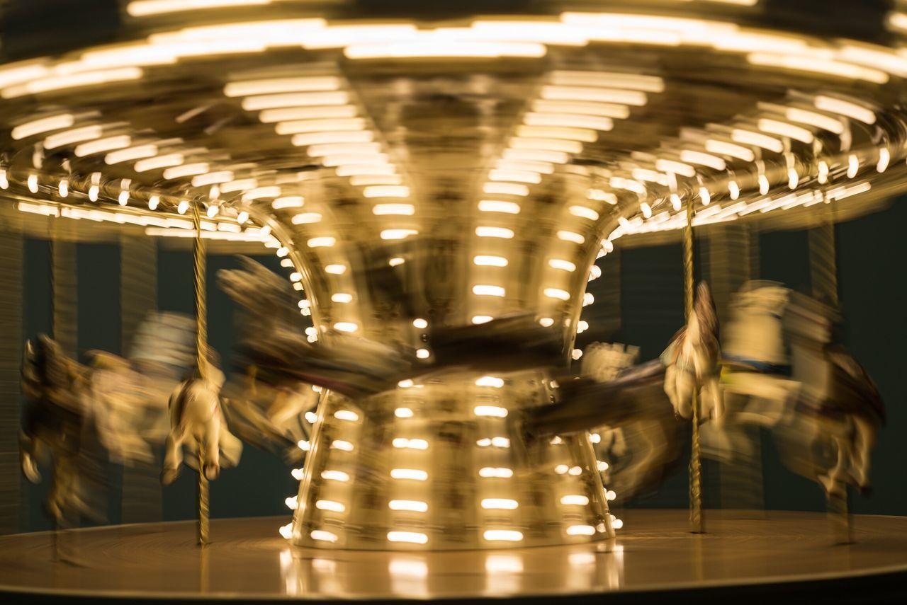 Blurred motion of illuminated carousel