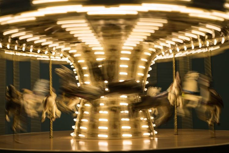 Blurred Motion Of Illuminated Carousel