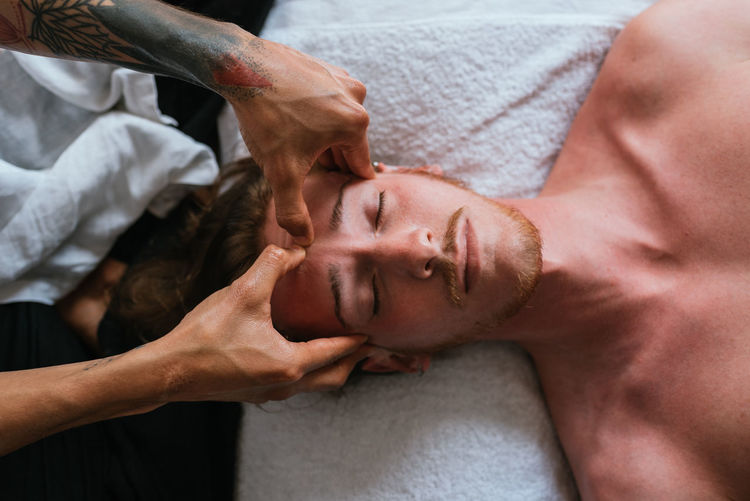 Portrait of shirtless man lying down