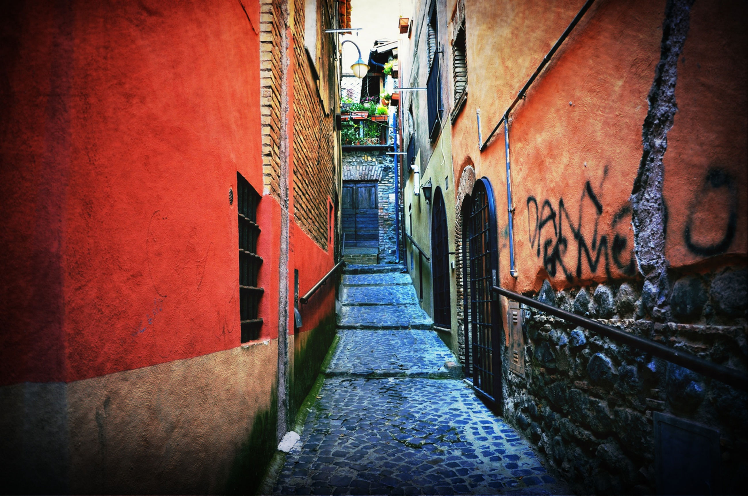 architecture, built structure, building exterior, the way forward, wall - building feature, building, steps, narrow, street, alley, diminishing perspective, residential building, city, residential structure, no people, day, outdoors, wall, steps and staircases, railing