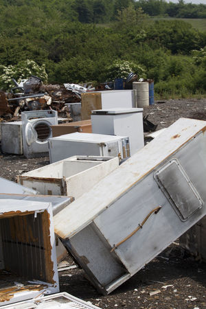 Old home appliances dumped at the landfill Contamination Disposal Fridge Garbage Dump Nature Consumerism Consumption  Dump Environment Freezer Fridges Garbage Home Appliances Household Appliances Junkyard Landfill Old Outdoors Pollution Recycle Recycling Recycling Center Vertical Photography Washing Machine Waste