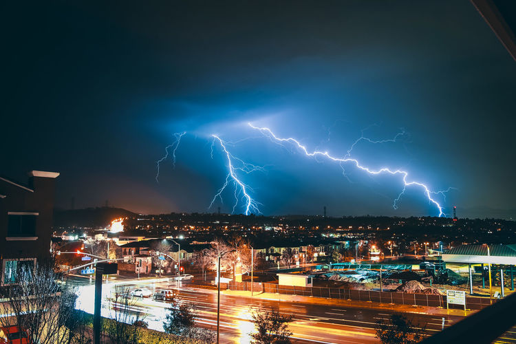 ELECTRIC Lightning Architecture Power In Nature Night Illuminated City Building Exterior Power Built Structure Storm Sky Cloud - Sky Thunderstorm Cityscape Nature Building Forked Lightning No People Beauty In Nature Electricity  Outdoors Light