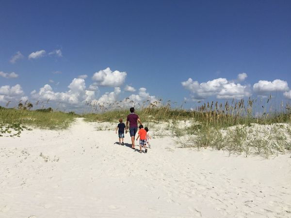 Family enjoying a day at the beach Jetty Park Port Canaveral Canaveral Florida Florida Beach Sand Dunes Sea Oats Clouds And Sky Family Time FamilyTime Family Walks Showcase July