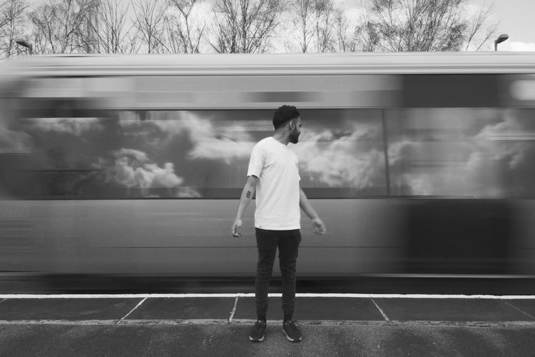 Passing Train Black And White Blackandwhite Casual Clothing Cloud Day Fast Grayscale Motion Motion Blur Outdoors Reflection Reflections Shutterspeed Sky Slow Shutter Train Train Station Transport Transportation Travel Traveling Travelling Travelphotography