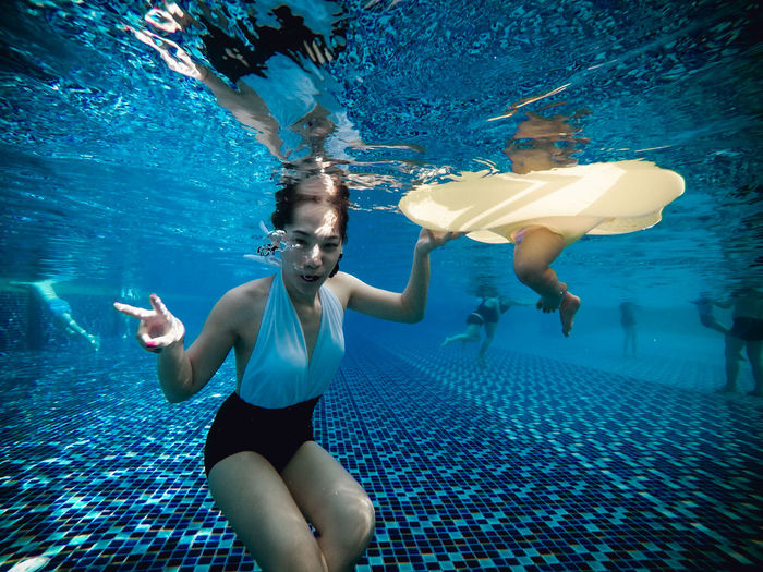 under the pool Underwater Swimming UnderSea Underwater Diving Only Women Water Mature Adult People One Woman Only Scuba Diving Adult Swimming Pool Looking At Camera Mature Women Portrait Snorkeling Adults Only Adventure