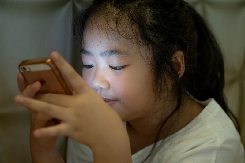 Portrait of girl using mobile phone