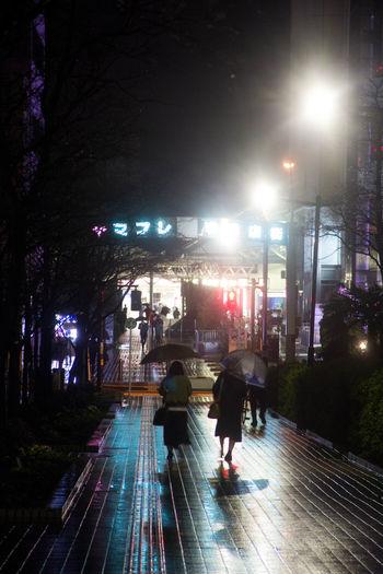 Rain Reflection City Life Large Group Of People Night People Street Light Walking