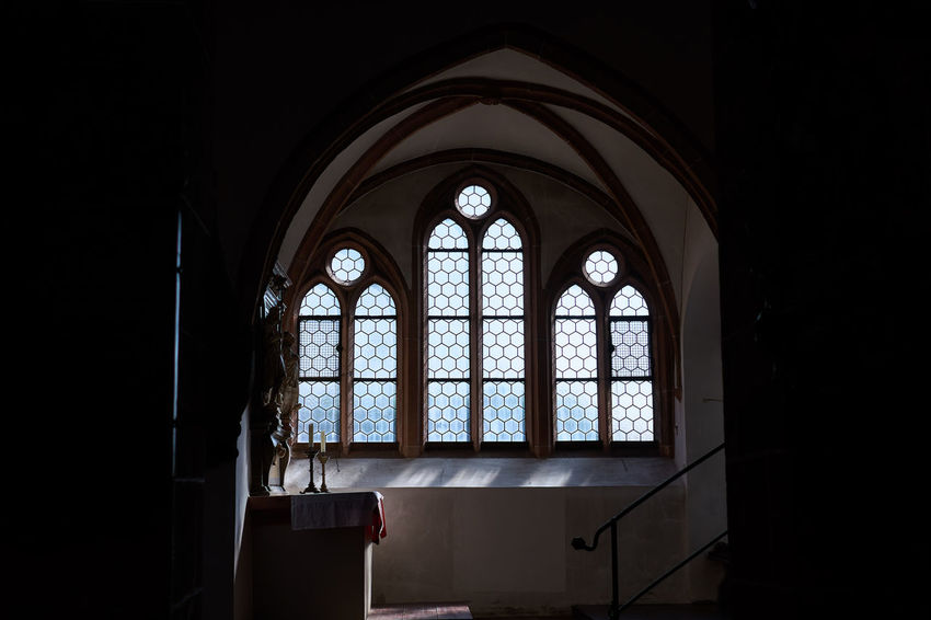 Aschaffenburg Stiftsbasilika Window Arch Church Place Of Worship Darkness And Light Light And Shadow Architecture Religion History Indoors  Travel Destinations Single Light Source Tranquility Silence Spirituality Bavaria Shootermag Lucky's Colors Mood Candle Melancholy Historic Altar