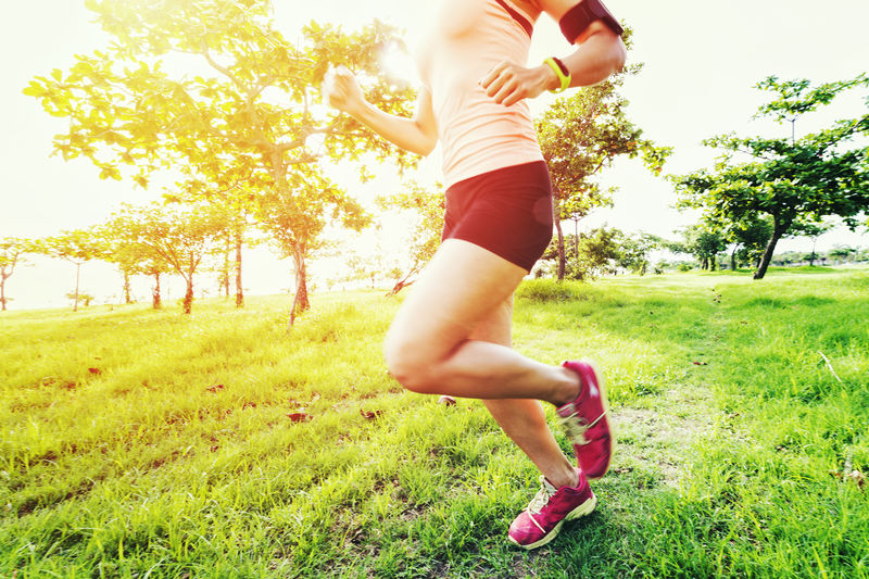 Low Section Of Woman Running At Park