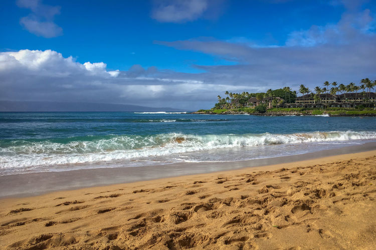 Scenic view of napili bay beach on the hawaiian island of maui, usa against sky
