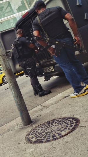 Two heavily armed police officers of the special operations division of Rio de Janeiro. Law Police Force Occupation Adults Only Men Outdoors People Low Section Brazilian Bope  Security Safety Guns Rifles Assault Rifles Only Men Adult Day Elite Crime Arrest Weapons Rio De Janeiro Editorial  Urban Lifestyle