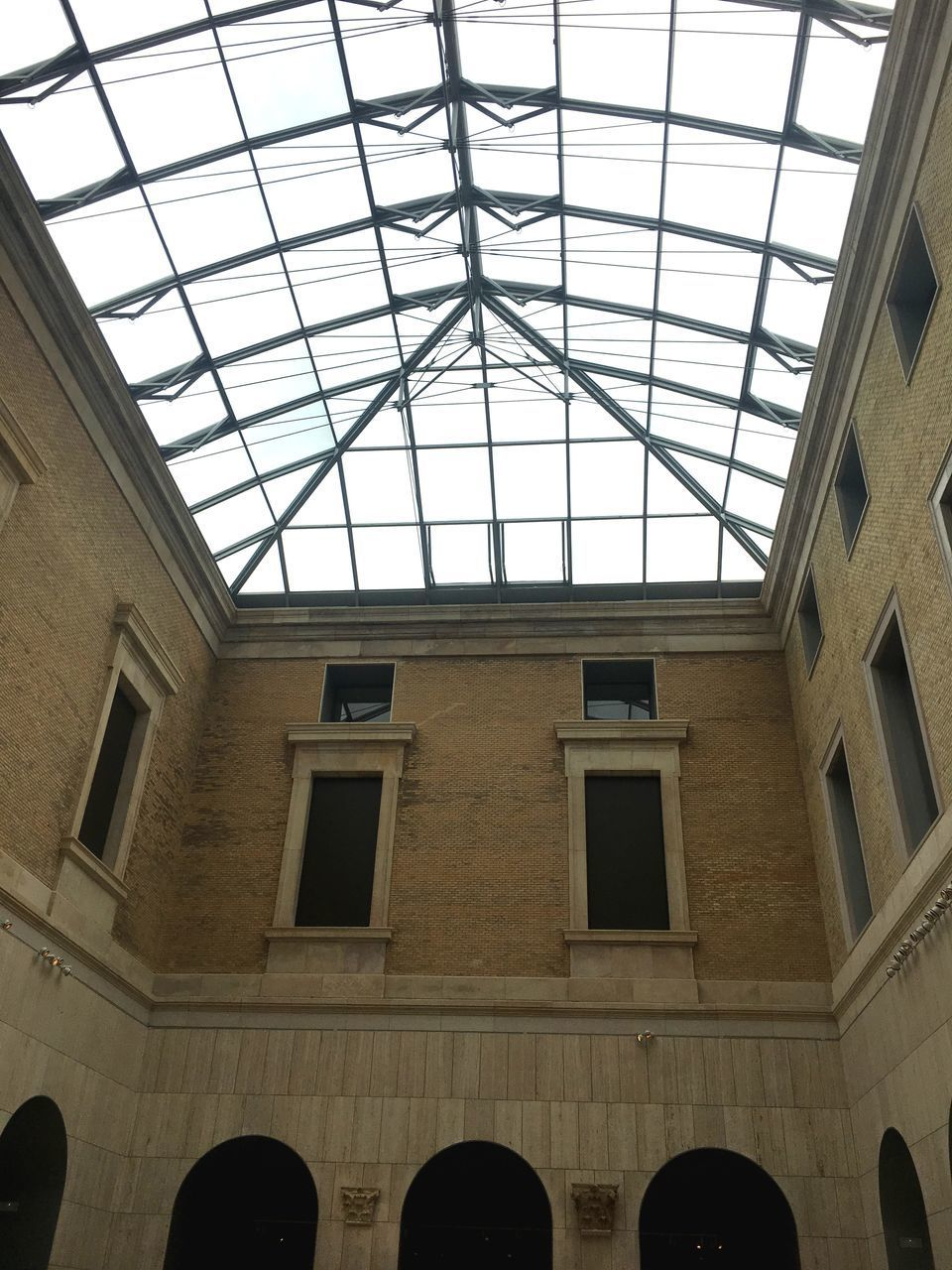 architecture, low angle view, built structure, window, indoors, arch, no people, ceiling, day, glass - material, building, skylight, travel destinations, pattern, history, transparent, the past, nature