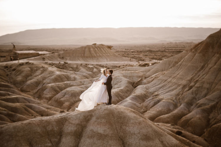 Woman with umbrella on desert