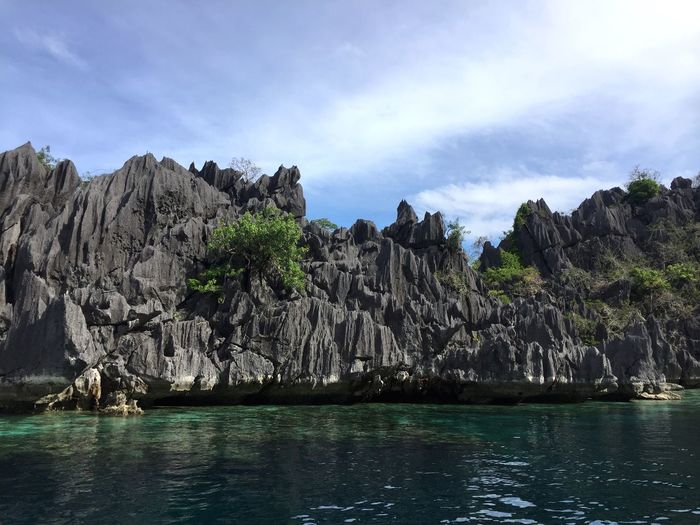 Water Sky Scenics - Nature Beauty In Nature Waterfront Tree Tranquility Tranquil Scene Nature Day Rock Formation Outdoors Cloud - Sky Non-urban Scene Sea Rock Plant Land