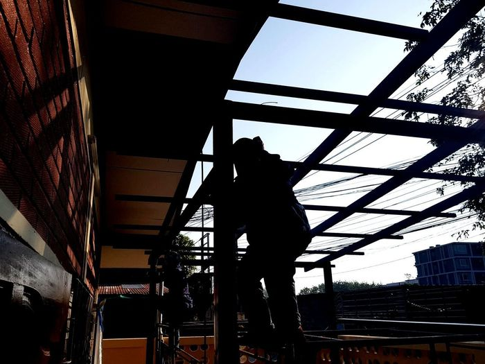Silhouette Indoors  Business Finance And Industry Built Structure Architecture Low Angle View People Day Adult Working Adults Only Only Men Sky