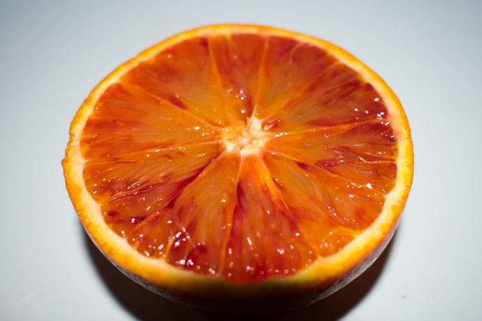 Blood Orange Citrus Fruit Close-up Cross Section Day Drink Food Food And Drink Freshness Fruit Halved Healthy Eating Indoors  No People Orange - Fruit Orange Color Ready-to-eat SLICE Sour Taste Studio Shot