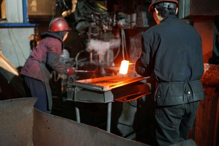 Workers Working In Metal Industry