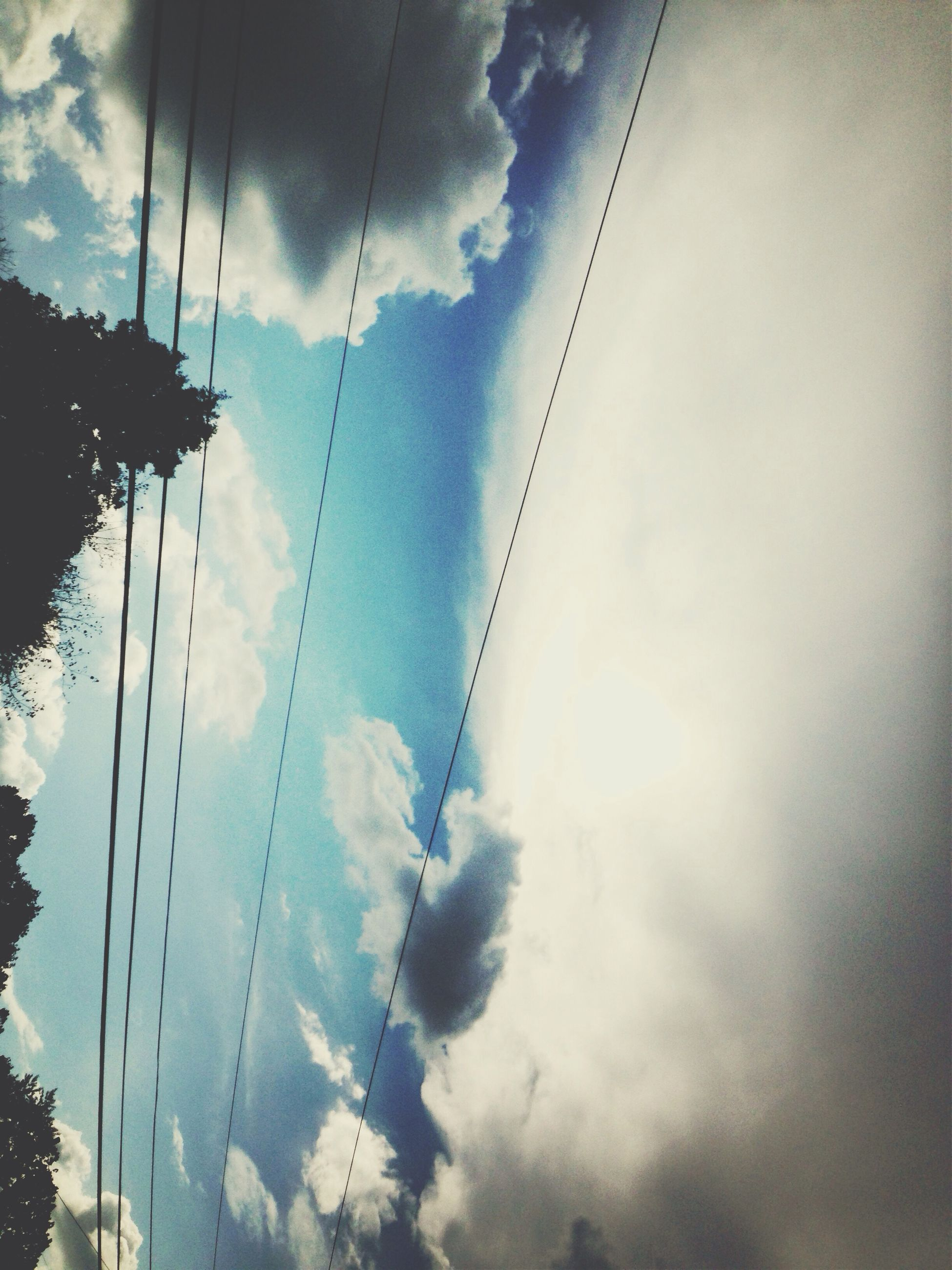 sky, cloud - sky, low angle view, connection, power line, cloudy, cable, transportation, electricity pylon, electricity, cloud, built structure, power supply, bridge - man made structure, architecture, outdoors, no people, nature, weather, day