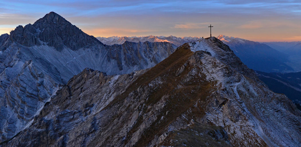 Scenic view of snowcapped mountains against sky during sunrise