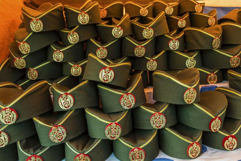 Full frame shot of stacked uniform caps