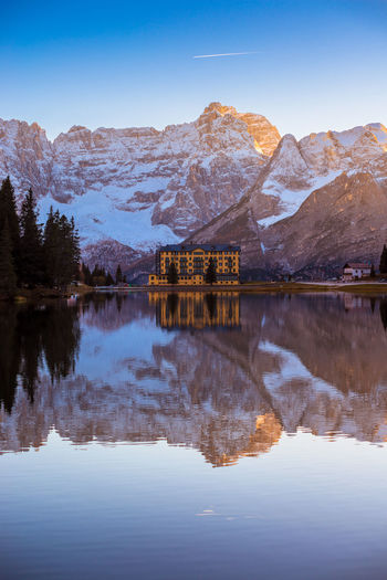 Lake Misurina Dolomites Beauty In Nature Building Day Hotel Idyllic Italy Lake Mountain Mountain Range Nature No People Outdoors Reflection Reflection Lake Scenics - Nature Sky Snowcapped Mountain Symmetry Tranquil Scene Tranquility Travel Destinations Water Waterfront