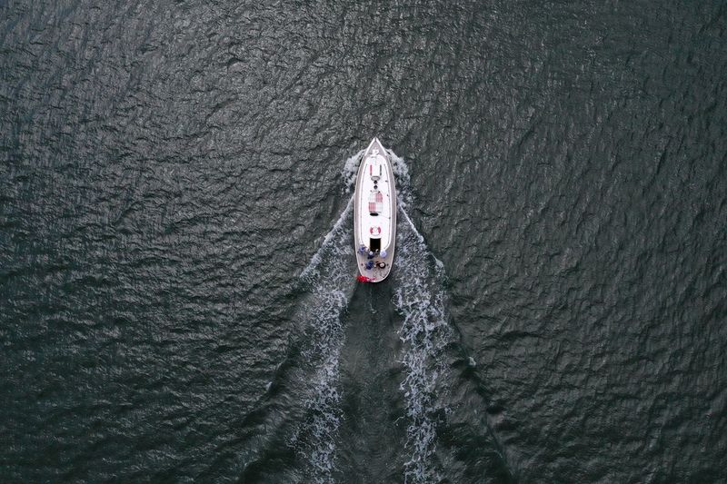 Full steam ahead Sea Sailing EyeEm Selects Transportation High Angle View Day Real People Road Nature Lifestyles Leisure Activity Mode Of Transportation Outdoors Men Nautical Vessel Water Waterfront