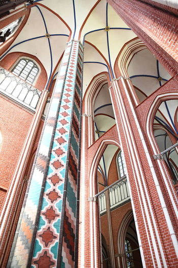Münster Bad Doberan innen Münster Bad Doberan Innenansicht Kirchenschiff Low Angle View Architecture Built Structure Window Building Exterior Building No People Glass - Material Day Arch Outdoors Glass Wall Stained Glass Lighting Equipment Pattern Reflection Red Multi Colored Ceiling Electric Lamp
