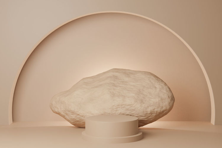 Close-up of illuminated lamp on table against wall