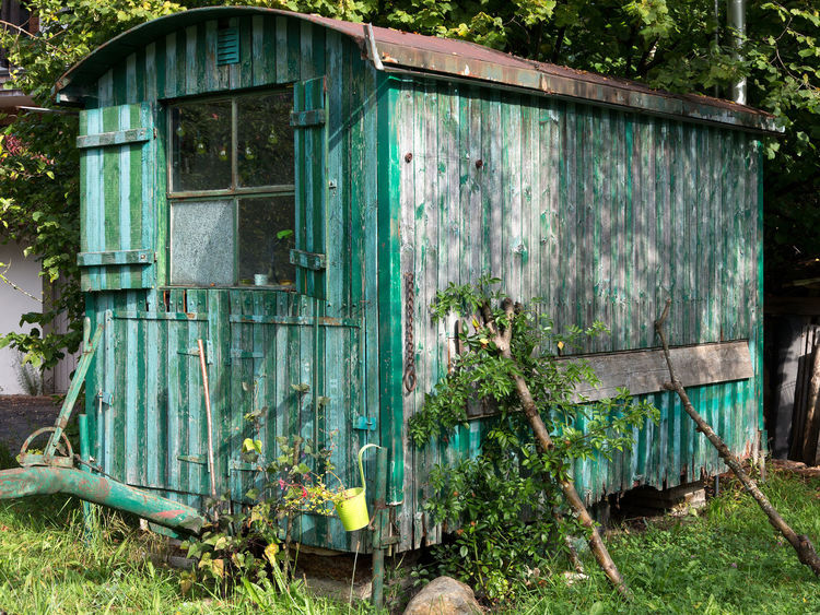 Old weathered wooden contractor's shed in the garden Gypsy Overgrown Rustic Weathered Abandoned Architecture Building Exterior Built Structure Cabin Contractor's Shed Cottage Garden Grass Green Color Hut Nature No People Old Outdoors Plant Shack Shed Vintage Window Wood - Material