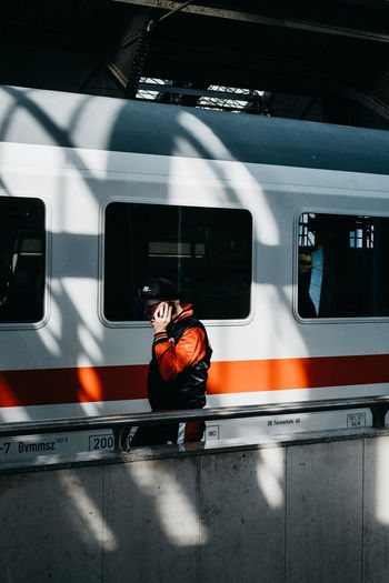 Man in train at railroad station