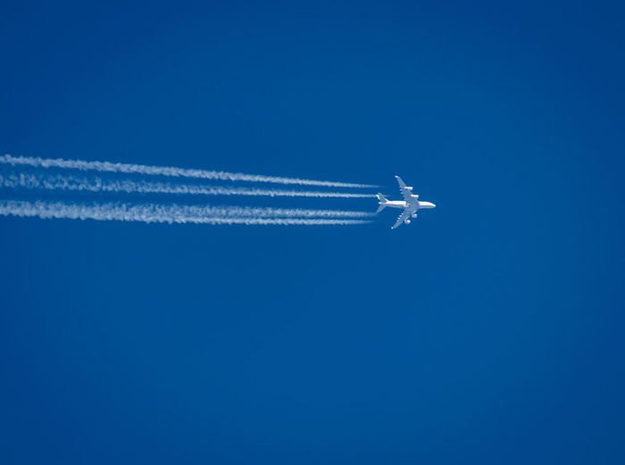 Airplane flying against blue sky