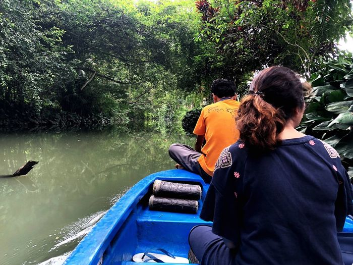 Boat trip to mangrove forest. Adventure Mangrove Forest EyeEm Selects Water Real People Rear View Men Nature Day Sitting Transportation Nautical Vessel People Lifestyles Mode Of Transportation Adult Lake Leisure Activity Outdoors
