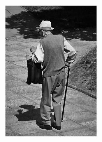 Piotr Adamczyk Photography Auto Post Production Filter Casual Clothing City Clothing Day Full Length Hat Lifestyles Men Nature One Person Outdoors Real People Rear View Shadow Street Sunlight Transfer Print Uniform Walking Adventures In The City