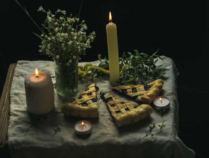 Still life. Pie. Currant pie. Spring still life. Candle Burning Fire Flame Indoors  Fire - Natural Phenomenon Heat - Temperature No People Illuminated Nature Table Food And Drink Food Freshness Still Life Glowing Close-up Variation Celebration Choice Candle Candlelight
