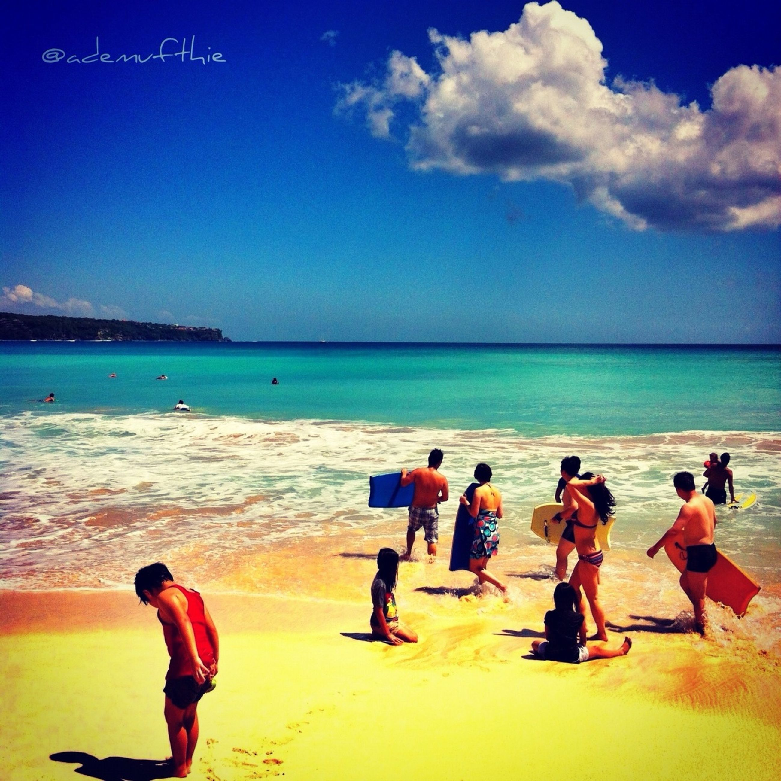 sea, horizon over water, beach, water, togetherness, leisure activity, lifestyles, vacations, shore, sky, enjoyment, bonding, blue, men, love, person, sand, childhood, family