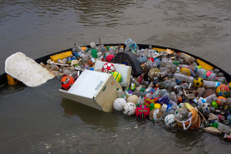 High angle view of garbage floating on river