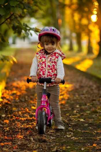 I like to ride my bike Autumn Baby Beauty In Nature Bicycle Child Childhood Cute Day Full Length Fun Grass Happiness Headwear Nature One Girl Only One Person Outdoors Pedal People Riding Smiling Toddler