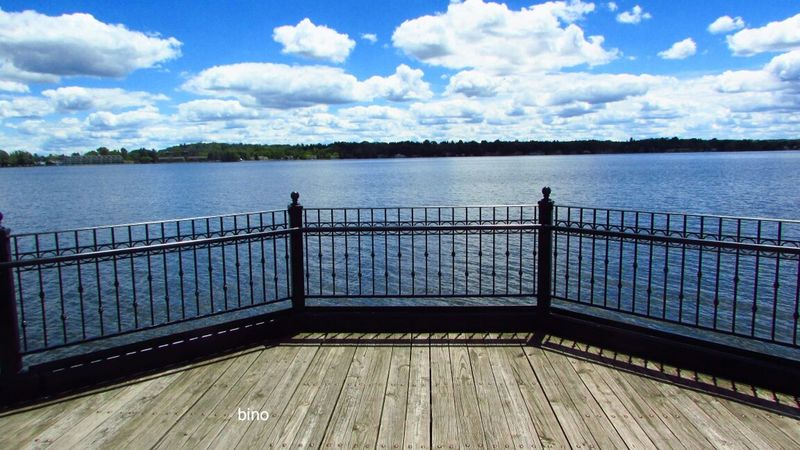 Taking Pictures Around The Lake Railing From The Footbridge Beautiful Blue Sky☁ Cloud Formations Lake Cadillac Pure Michigan