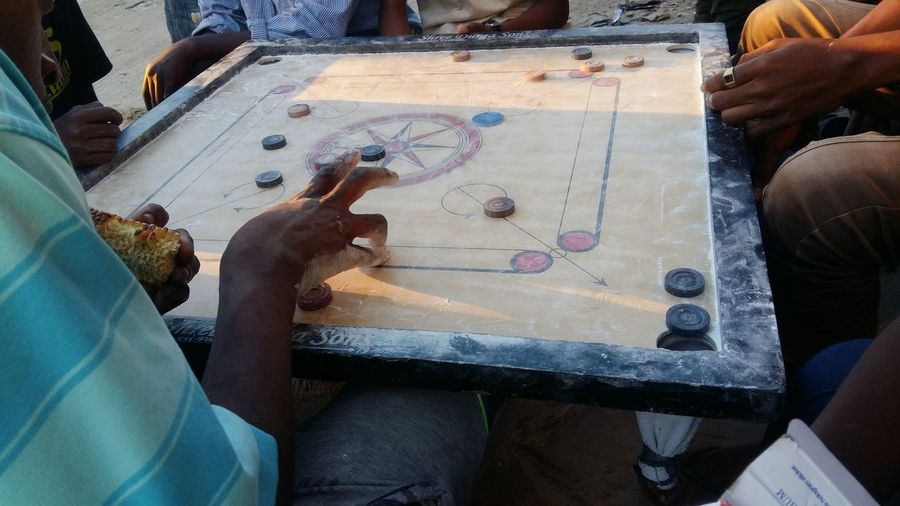 Playing Kelam in the streets Street Photography Group Of People Playing Games Kelam Human Hand Workshop Working Togetherness Skill  Work Tool Men Craftsperson Holding Artist Craft Art And Craft Male Likeness