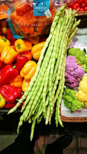 Have you ever wondered how freshness can be packed? Here, done. Colours Rainbow Rainbow Colors Freshness Beans Supermarket Market Vegetable Variation Close-up Green Color Food And Drink Display Stall Raw Market Stall Cauliflower For Sale Pepper